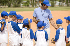 Free Little League Baseball Team And Coach On Pitch Stock Photography - 67236562