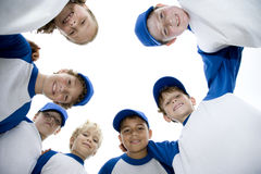 Little league baseball team standing in a circle Royalty Free Stock Image