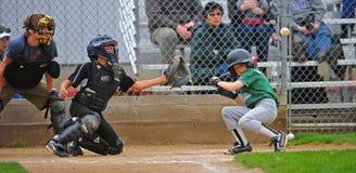Little League Batter ducking Stock Photos