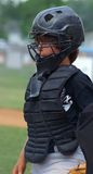 Little League catcher. Baseball catcher during a little league game with all gear Royalty Free Stock Image