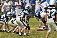 Little League Football. A group of young boys on the field ready to make the snap. A boys team of 7-8-9 year olds during a game at the Forsyth County, Cumming GA Stock Photography
