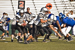 Little League Football Blocking for the Play stock photo