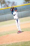 Little league pitcher starting his wind up. Little league pitcher starting his wind up to pitch to the ball Stock Photography