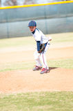 Little league pitcher starting his wind up. Little league pitcher starting his wind up to pitch to the ball Stock Photos