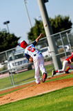 Little league pitcher throwing to first Royalty Free Stock Photography