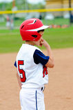 Little league player on base. Royalty Free Stock Photography