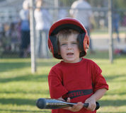 Little League player Holding Bat Royalty Free Stock Photography