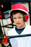 Little league player up close. Up-close shot of little league baseball boy about to bat royalty free stock photo