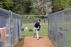 Little league player warming up. Royalty Free Stock Images