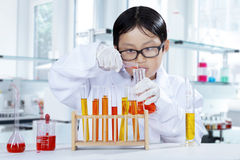 Little learner try to make chemical experiment Stock Photos