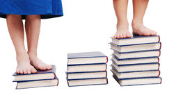 Little legs standing on books stairs isolated Stock Photography