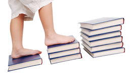 Little legs stepping on books stairs Stock Photo