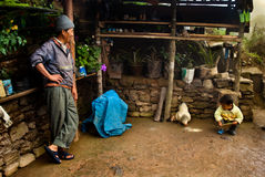 A little Lepcha boy and hen family Royalty Free Stock Images