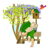 Little leprechaun with a birdhouse Royalty Free Stock Photo
