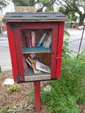 Little library. Books red box stock photography