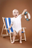 Little lifeguard. Little todler holding lifebuoy, studio portrait royalty free stock photography