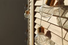 Little light bulbs in yellow lsght stock photo