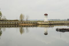 Little lighthouse on a small island. Lighthouse is located in a town Kremenchug stock images