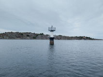 Little lighthouse on sweden westcoast. Help for the boat to come right Royalty Free Stock Images
