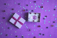 Free Little Lilac Gift Box On Purple Background.The Ultraviolet Colour Of The Year Stock Image - 112820761