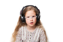 Little little girl is listening to music Stock Photo