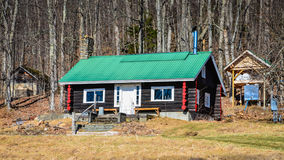 Little Log Cabin in the Woods Stock Photography