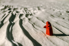 Little lonely red man stay Stock Photo