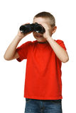 Little looking away through the binoculars Royalty Free Stock Images