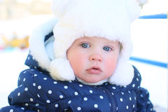 Little lovely baby girl 11 months in warm clothes outdoor in win Royalty Free Stock Photos