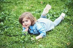 Little lovely girl lie on green grass. And enjoy summer life royalty free stock photos