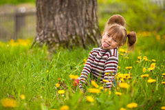 Little lovely girl playing in the park Royalty Free Stock Photography