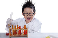 Little mad scientist doing research. Portrait of little mad scientist doing research, isolated over white background Stock Images