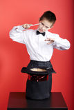 Little magician with rabbit Royalty Free Stock Image