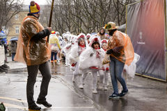 Little majorettes wrapped up against rain at Carnival parade Royalty Free Stock Image