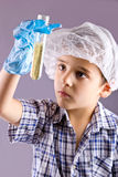 Little male child have experiment with test tubes Royalty Free Stock Photo