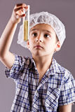 Little male child have experiment with test tubes Stock Image
