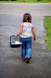 Little Mama. Four year old girl carrying her baby doll in an infant carrier Stock Images