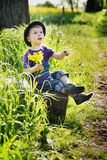 Little man with bouquet of flowers Royalty Free Stock Photos