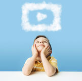 Little man dreaming about cloud shapes Stock Photos