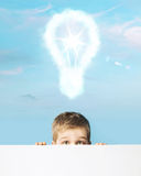 Little man with a light bulb above head Stock Photography