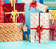 Little man looking for his gift Royalty Free Stock Image