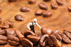 The little man made ​​coffee selection. The concept of cooki Royalty Free Stock Photo
