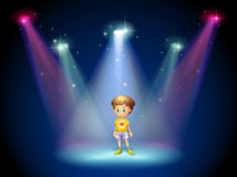 A little man in the middle of the stage with spotlights Stock Photos