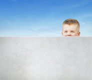 Little man playing hide and seek Royalty Free Stock Photos