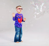Little man playing with soap bubbles Stock Photo