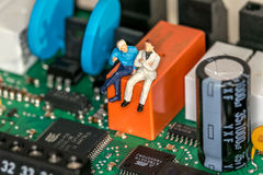 Little Man siting on a Motherboard Stock Photography