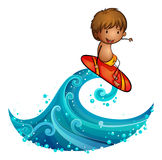 A little man surfing Royalty Free Stock Images