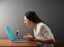 Little man from technical support looking at woman Royalty Free Stock Image