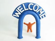 Little man and welcome gate Royalty Free Stock Image