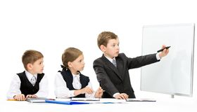 Little manager showing smth to little business people Royalty Free Stock Photos